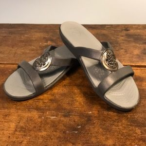 Black Croc Slides with medallion embellishment